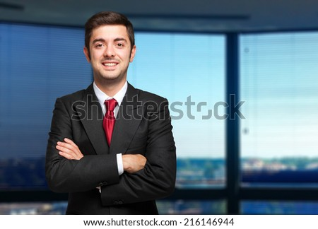 Portrait of a young businessman in a modern office