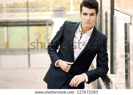 Portrait of a young businessman in urban background