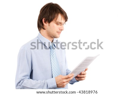 Portrait of a young businessman reading a report, isolated on white background