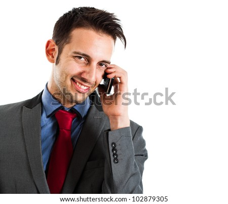 Portrait of a young businessman using a smartphone