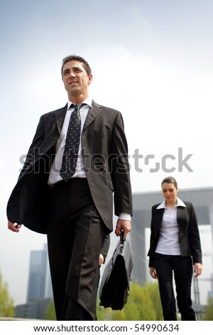 Portrait of a young businessman walking in the street