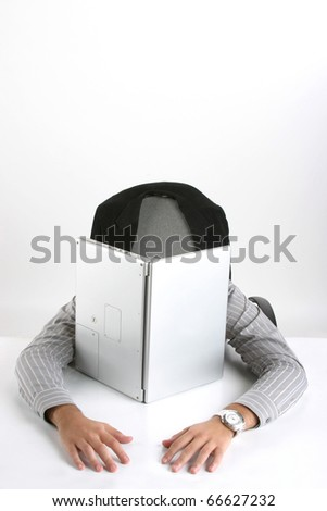 Portrait of a young businessman with laptop relaxing on chair against white background