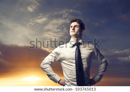 Portrait of a young businessman with sunrise in the background