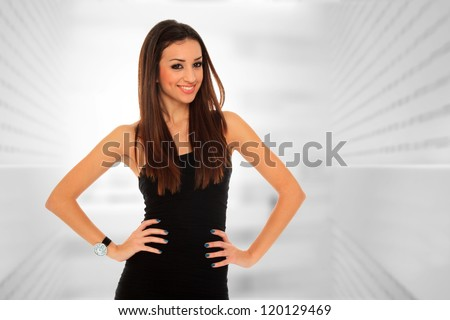Portrait of a  young businesswoman, at corporate