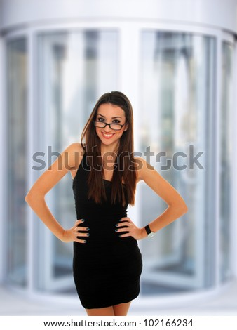 Portrait of a  young businesswoman at corporate entrance