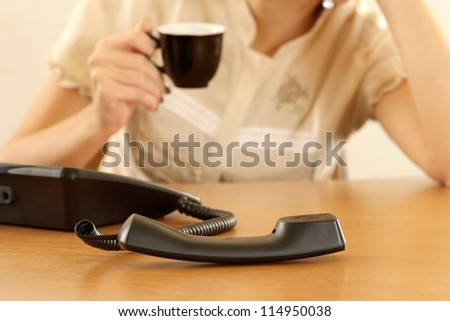 portrait of a young businesswoman drinking coffee in office
