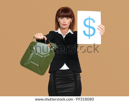 portrait of a young businesswoman, holding a gas canister and a dollar sign in her hands, on beige background
