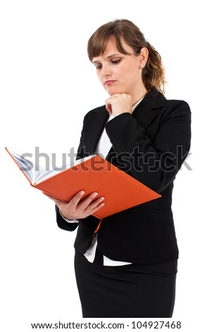 Portrait of a young businesswoman reading a notebook isolated on white - stock photo