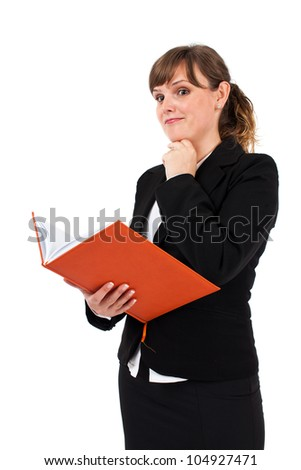 Portrait of a young businesswoman reading a notebook isolated on white