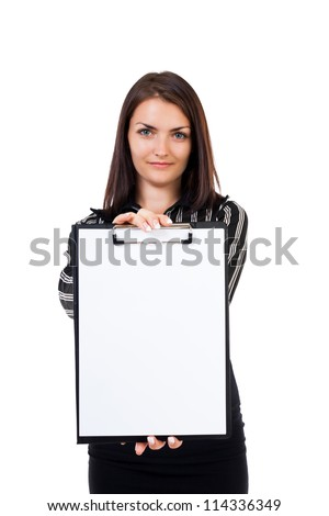 Portrait of a young businesswoman showing a blank clipboard