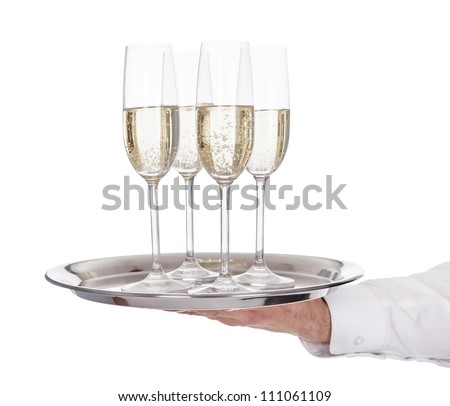 Portrait of a young butler with champagne glass. Isolated on white
