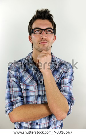 portrait of a young casual man thinking