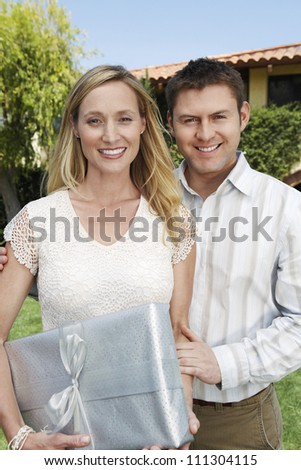 Portrait of a young caucasian couple with gift