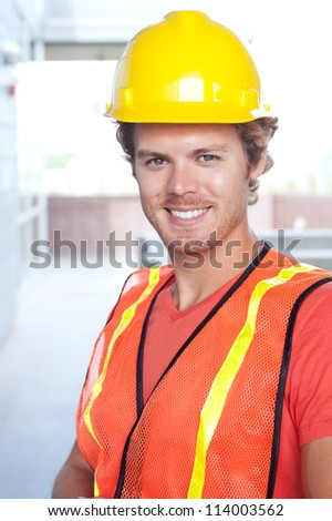 portrait of a young construction worker outside