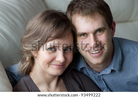 Portrait of a young couple at home