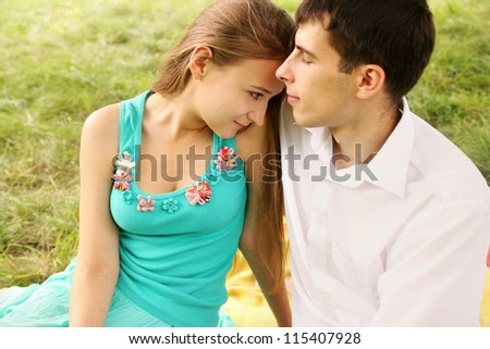 Portrait of a young couple sitting hugging each other