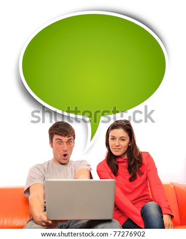 Portrait of a young couple using a computer. Isolated white background. - stock photo