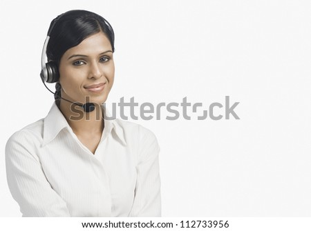 Portrait of a young customer service representative smiling - stock photo