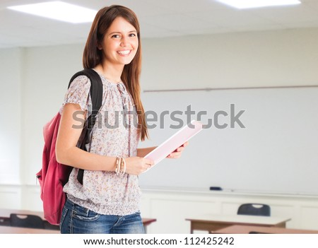 Portrait of a young cute student in her classroom