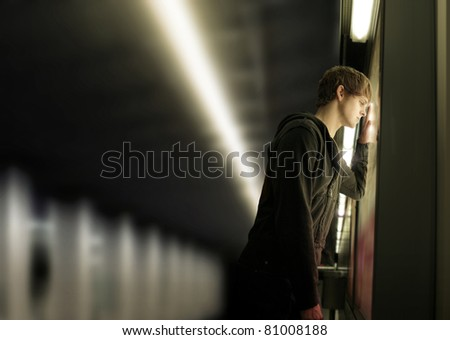 Portrait of a young depressed man in subway station