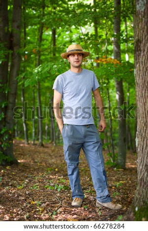 Portrait of a young farmer in the forest - stock photo