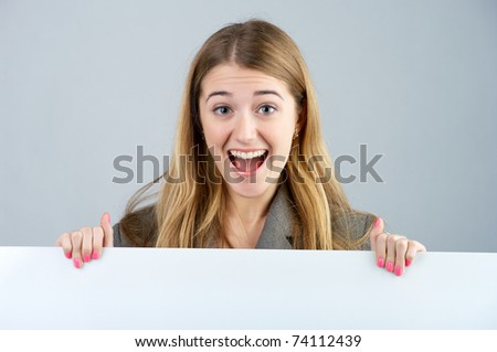 Portrait of a young female holding a blank bill board
