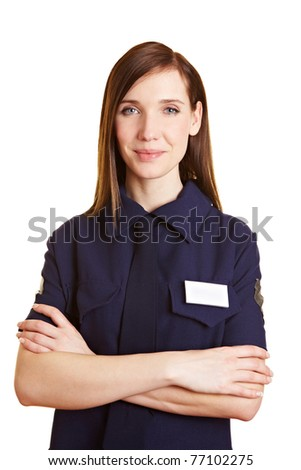 Portrait of a young female police officer with arms crossed