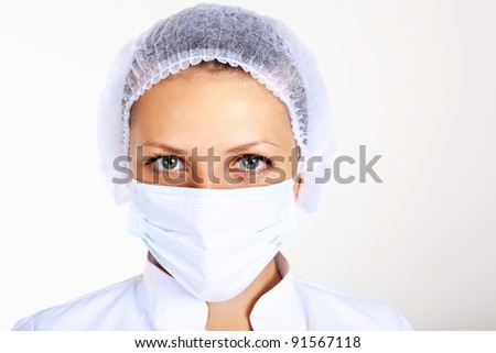 Portrait of a young female scientist wearing face mask - stock photo