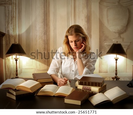 portrait of a young female student underlining and reading books in a ancient interior