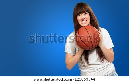 Portrait Of A Young Female With A Football Soccer Ball On Blue Background