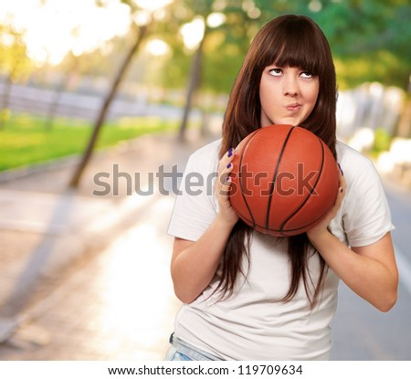 Portrait Of A Young Female With A Football Soccer Ball, Outdoor