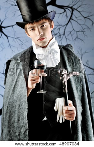 http://image.shutterstock.com/display_pic_with_logo/67164/67164,1268821795,14/stock-photo-portrait-of-a-young-gentlemen-wearing-dinner-jacket-and-black-top-hat-shot-in-a-studio-48907084.jpg