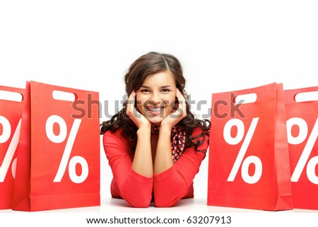 Portrait of a young girl among discount paper bags