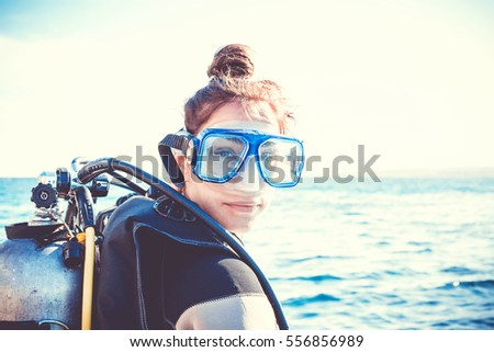 Portrait of a young girl diver on a sunny day. #556856989