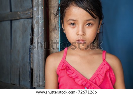 stock photo Portrait of a young girl from povertystricken area in Manila