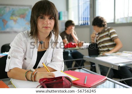 Portrait of a young girl in a classroom
