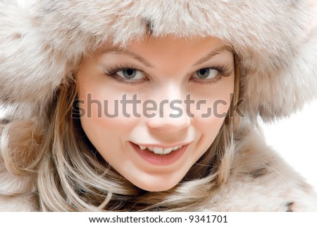 Portrait of a young girl in fur hat