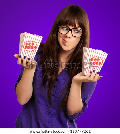 Portrait Of A Young Girl Making Face On Purple Background