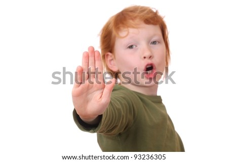 Portrait of a young girl making stop gesture on white background