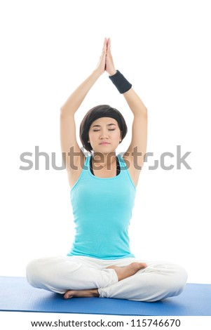 Portrait of a young girl meditating isolated on white