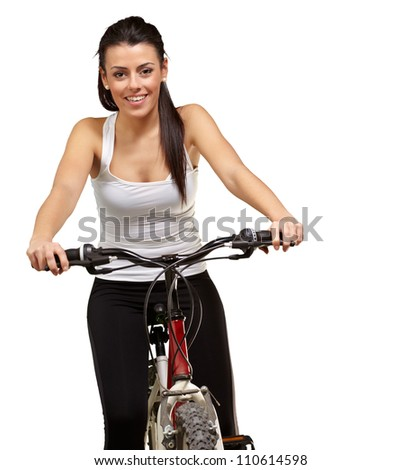Portrait of a young girl sitting in bicycle isolated on white background