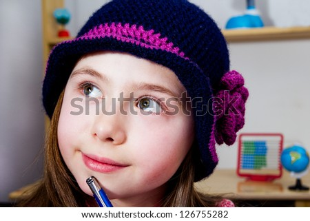 Portrait of a young girl thinking about school problem