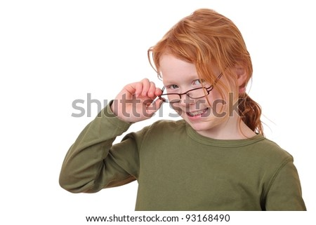 Portrait of a young girl wearing glasses on white background