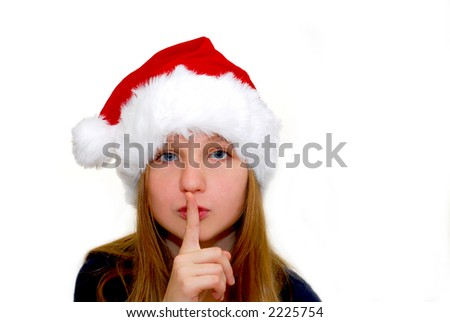 Portrait of a young girl wearing Santa\'s hat isolated on white background