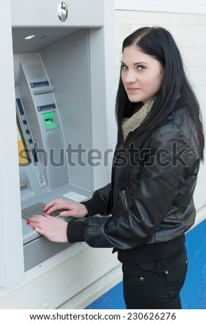 Portrait of a young girl with a cash card