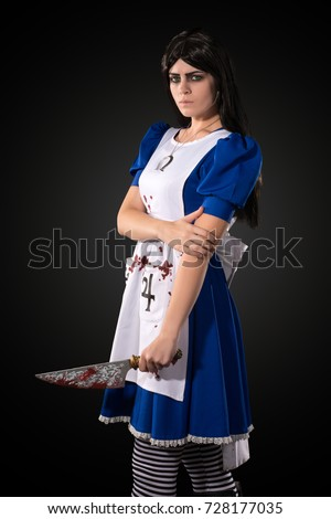 Stock Photo Portrait of a young girl with a knife, Cosplay from a video game Alice Madness Returns