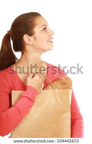 Portrait of a young girl with a shopping bag isolated on white background - stock photo