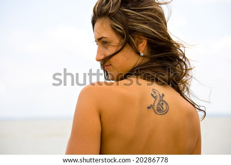 stock photo portrait of a young girl with tattoos on her back