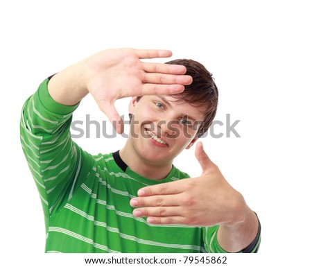 Portrait of a young guy framing his head with hands, closeup