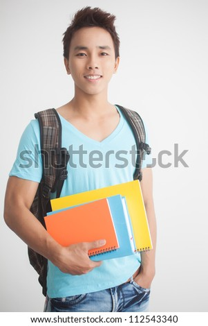 Portrait of a young guy with books